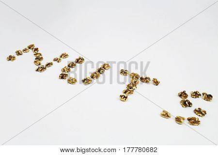 Walnuts shaped to spell the word NUTS