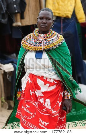 MARARAL KENYA - JULY 03: African woman from the Samburu tribe with characteristic decorative necklaces on the market in the Mararal town in Kenya Mararal in July 03 2013