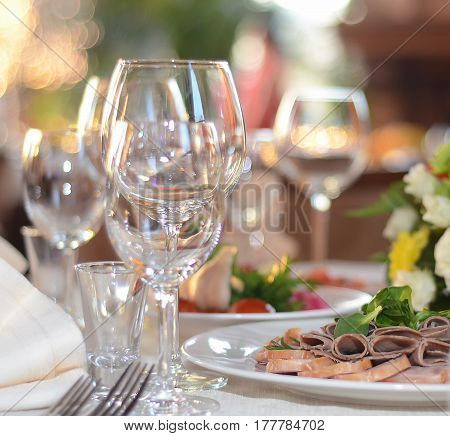 A bright picture with glasses and snacks on the festive table