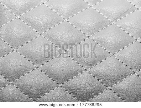 quilted texture artificial leather stitched with thread for the background for texture