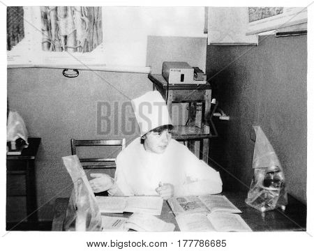 VITEBSK BELARUS - CIRCA 1987: Student of Vitebsk of Order of Friendship of Peoples Medical Institute on lessons at Department of Histology (vintage black and white photo 1987) Belarus