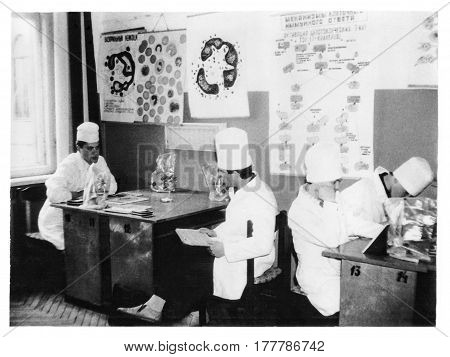 VITEBSK BELARUS - CIRCA 1987: Students of Vitebsk of Order of Friendship of Peoples Medical Institute on lessons in classroom at Department of Histology (vintage black and white photo 1987) Belarus