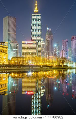 River And Modern Buildings Against Sky in TianjinChina.