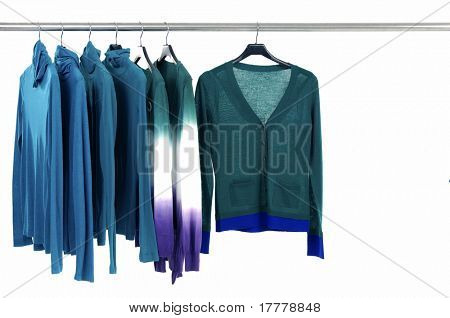 Blue knitted female clothing on hangers