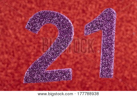 Number twenty-one purple over a red background. Anniversary. Horizontal