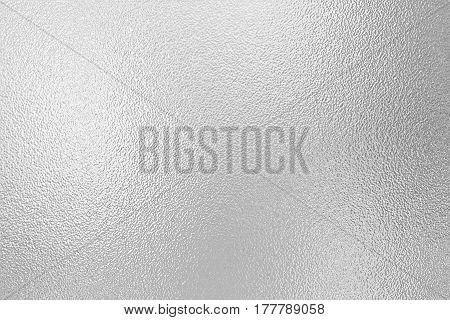 Shiny silver foil decorative texture background. Metallized paper