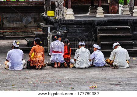 PURA BESAKIH, INDONESIA - SEPTEMBER 30, 2012: Praying people in Pura Besakih Temple in Bali Island Indonesia