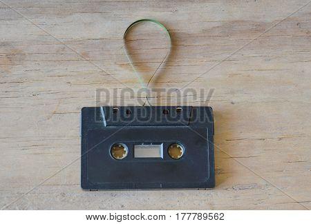 audio cassette tape recorder on wooden board