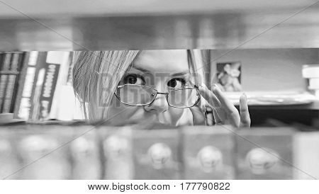 Beautiful Girl Among The Shelves
