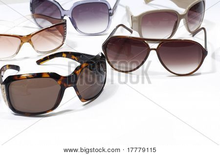 Different sunglasses on white