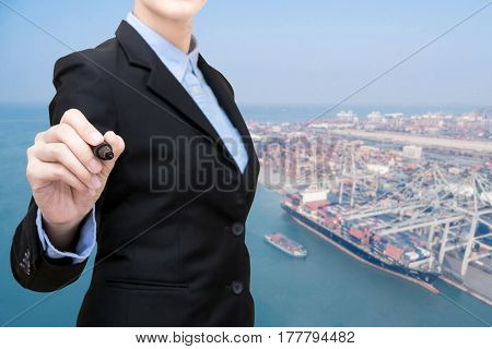 Business Woman Writing With Container Shipping Boat At Shipping Yard In Background.photo Concept For
