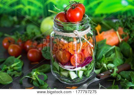 Fresh vegetarian salad in mason jar. Healthy food and diet.