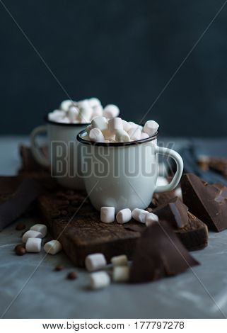 Two mugs of hot chocolate with a lot of little marshmallows. Delicious dessert for cold weather