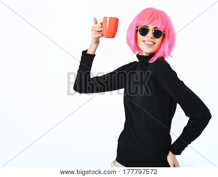 Fashionable Sexy Girl In Pink Wig Holding Orange Cup