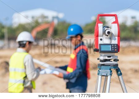Construction engineer and foreman worker checking construction drawing at construction site for new Infrastructure construction project