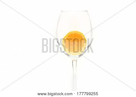 Slice Of Lemon In Glass Isolated On White Background