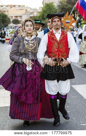 QUARTU S.E. ITALY - July 15 2016: 30 Sciampitta - International festival of folklore - couple parading in traditional Sardinian costume - Sardinia