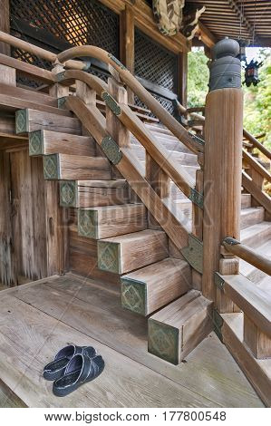 Japanese classic architecture of wooden stairway to a shrine