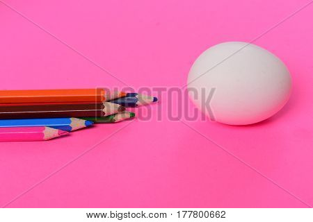 Easter Egg White Color And Colorful Pencil On Pink Background