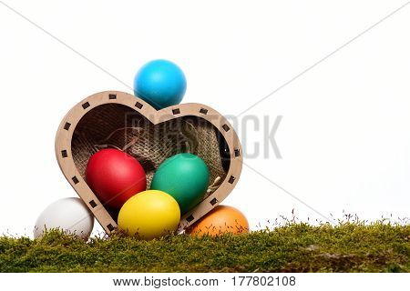 Easter Colorful Eggs In Wooden Heart Box Isolated On White