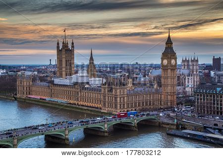London England - The famous Big Ben with Houses of Parliament and Westminster Bridge at sunset