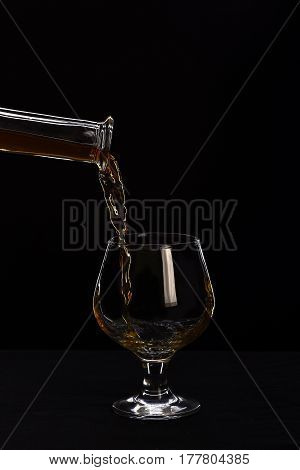Glass, Carafe With Cognac Or Whiskey Isolated On Black Background