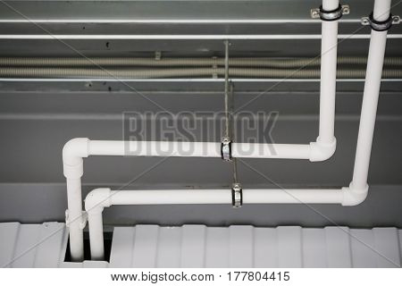 Fixing The Pipes Under The Ceiling