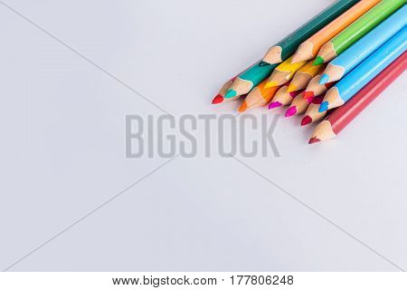 Beautiful and bright colored pencils on white background