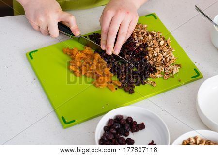 Preparing granola in the kitchen at home - healthy eating concept