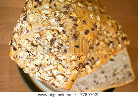 Whole Grain Bread Bun On A Plate On Wooden Table Background