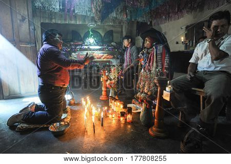 Maya Shaman With The Divinity Of Maximon At Santiago De Atitlan