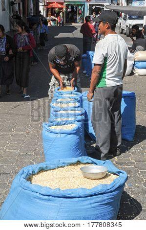 Santiago de Atitlan, Guatemala - 15 February 2014: Two person with bags of corn at Santiago de Atitlan on Guatemala