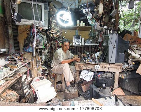 Repairman Of Household Appliances On His Workshop At Sayaxche