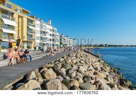 MALMO SWEDEN - JUNE 05 2011: People relaxing and sunbathe in Vastra Hamnen (The Western Harbour)