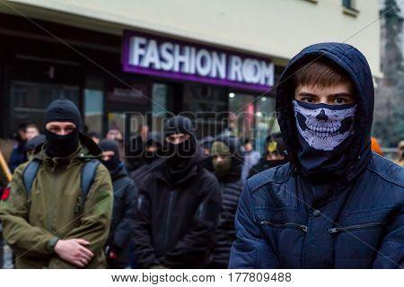 Uzhhorod western Ukraine - March 18 2017: Masked activists partake in the Black March of the Glory of the Heroes of Carpathian Ukraine in Uzhhorod