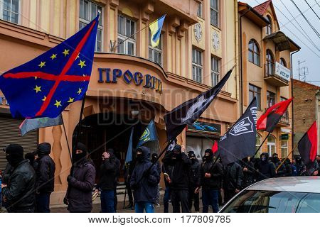 Uzhhorod western Ukraine - March 18 2017: Activists of the Black March of the Glory of the Heroes of Carpathian Ukraine walk through the streets of Uzhhorod western Ukraine