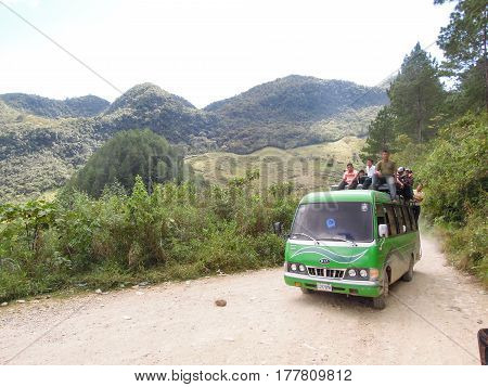 Truck Full Of People On A Dirt Mountain Road Near Lanquin, Guatemala