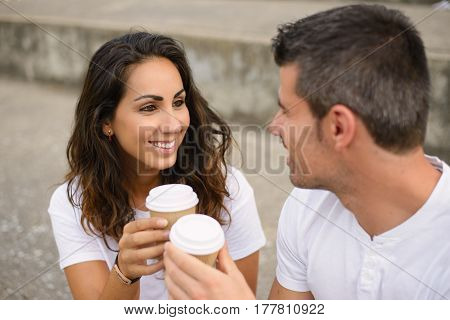 Happy Young Couple Dating And Drinking Coffee Outside