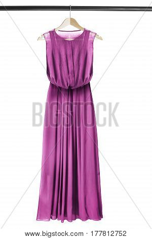 Magenta pink chiffon long dress on wooden clothes rack isolated over white