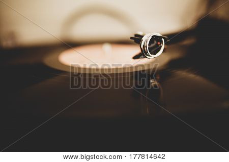 Silver Wedding Rings Hang Over The Plate