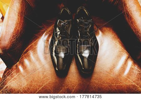 Patent Shoes Lie On The Leather Chair