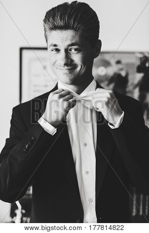 Man Smiles Sparkling Adjusting His White Bow Tie