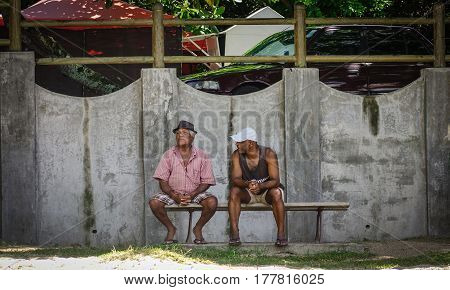 People Sitting On Street In Port Louis, Mauritius