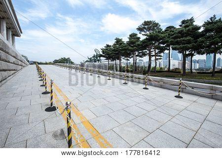 empty brick road by modern building in seoul