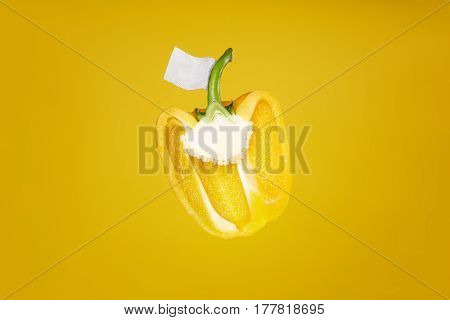 Yellow pepper on yellow background eco vegetable healty without label