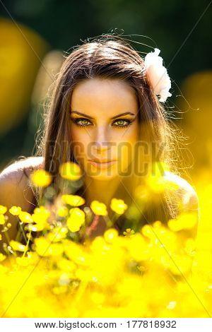 Beautiful woman portrait on bright summer meadow