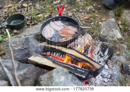 Fresh Meat Being Cooked Over Campfire