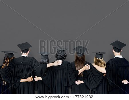 Backside View of Diverse Group Of Students Hugging Each Other
