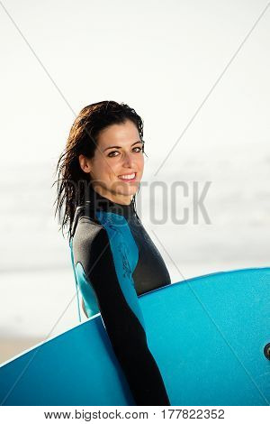 Portrait Of Surfer Woman With Bodyboard
