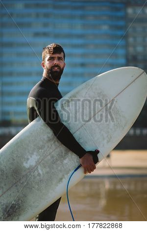 Man With Surfboard Before Surfing At City Beach